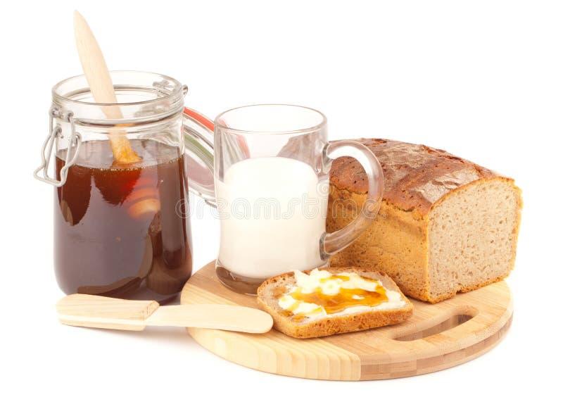 Pane di Rye con il latte di nad del miele immagine stock libera da diritti