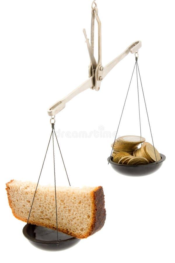 Pane nero e soldi fotografie stock