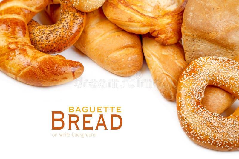 Pane, pagnotta, baguette, bagel su un bianco fotografie stock libere da diritti