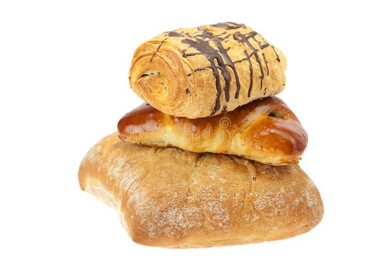 Pane, panino con i semi di papavero e rullo fotografia stock