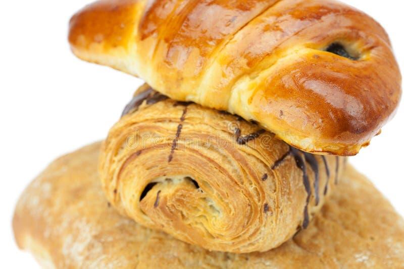 Pane, panino con il papavero e rullo con cioccolato immagini stock libere da diritti