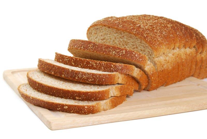 Pane su una scheda di taglio fotografia stock
