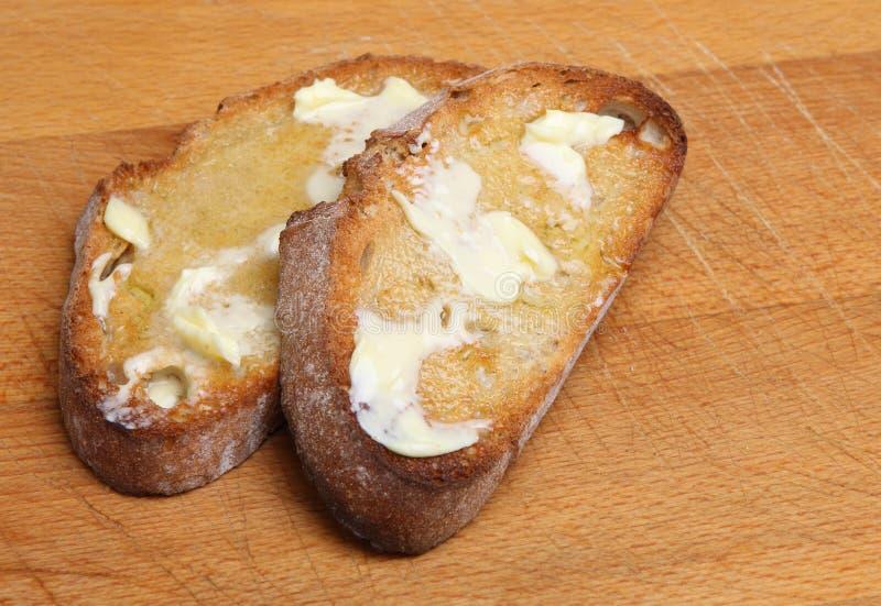 Pane tostato & burro immagini stock