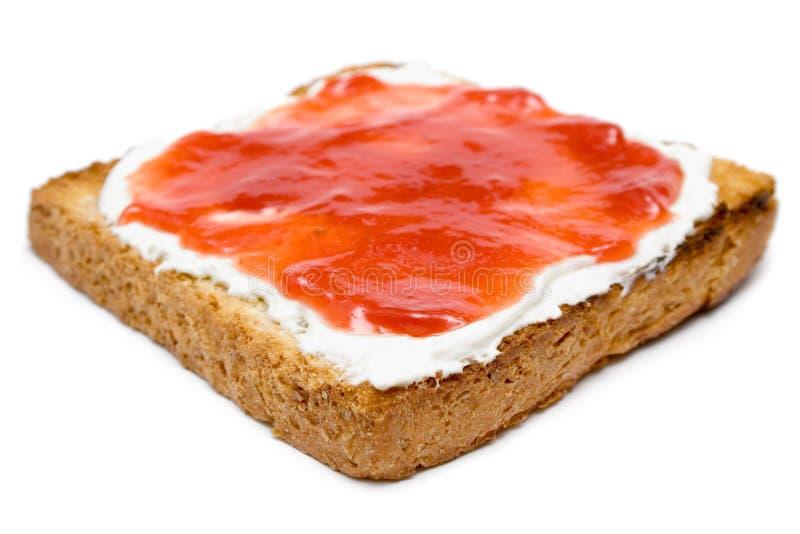 Pane tostato con burro ed ostruzione fotografie stock