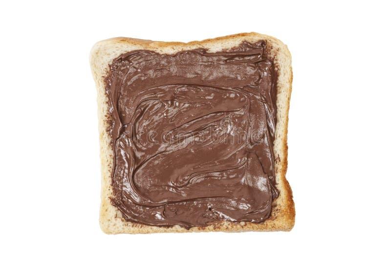 Pane tostato con la crema del nougat del cioccolato fotografie stock libere da diritti