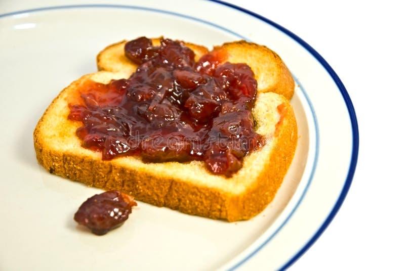 Pane tostato con la marmellata di amarene fotografia stock