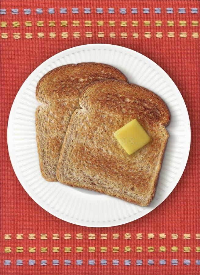 Pane tostato su Placemat arancione immagini stock libere da diritti