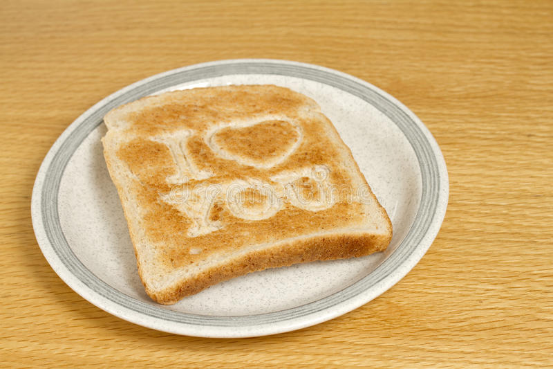 Pane tostato sulla zolla fotografia stock
