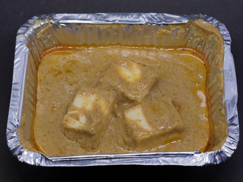 Paneer breder smör på Masala är mjuka stycken av Paneer i en rik, krämig och aromatisk sky som göras av smör, lökar & tomater royaltyfria foton