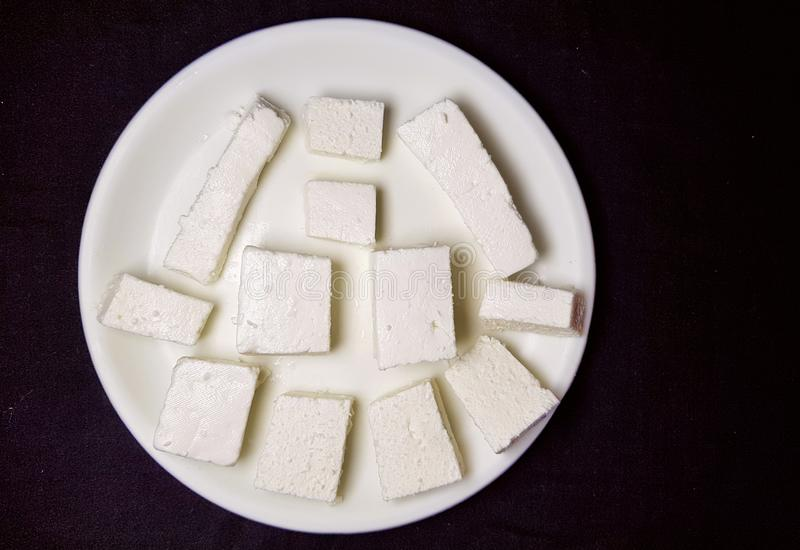 Paneer pieces in white plate stock photo