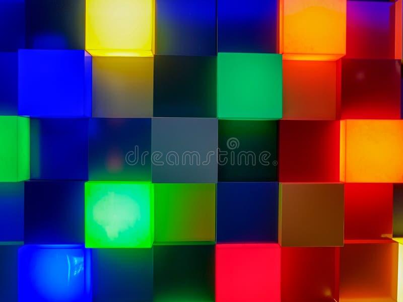 Panel av lysande fyrkanter i olika färger arkivfoto