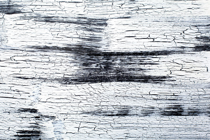 Panel with cracked paint, black and white craquelure, artificial. Wooden Panel with cracked paint, black and white craquelure, artificial aging, background stock images