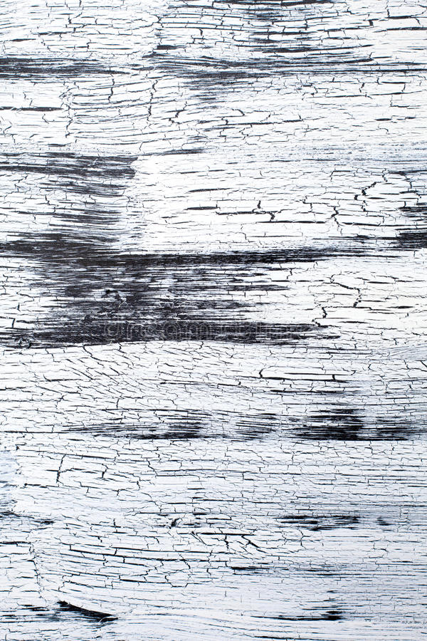 Panel with cracked paint, black and white craquelure, background. Wooden Panel with cracked paint, black and white craquelure, artificial aging, background stock photography