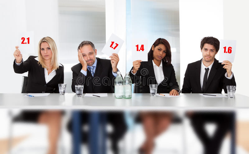 Download Panel Judges Holding Bad Score Signs Stock Image - Image: 25759891