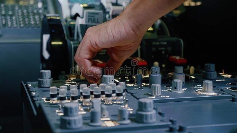 Panel of switches on an aircraft flight deck. Pilot controls the aircraft. Panel of switches on an aircraft flight deck, close-up. Pilot controls the aircraft royalty free stock photo