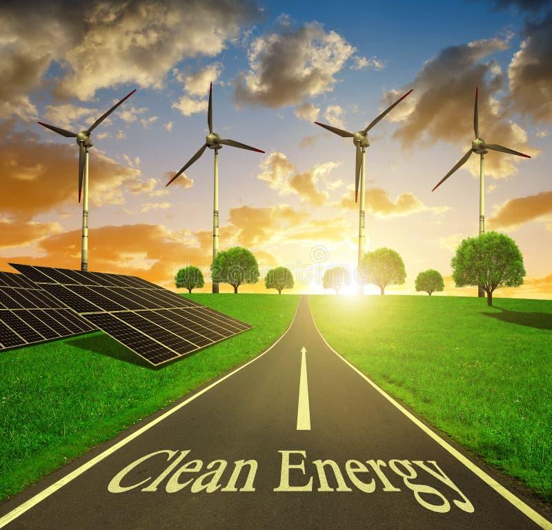 Paneler för sol- energi och vindturbiner på solnedgången royaltyfri foto