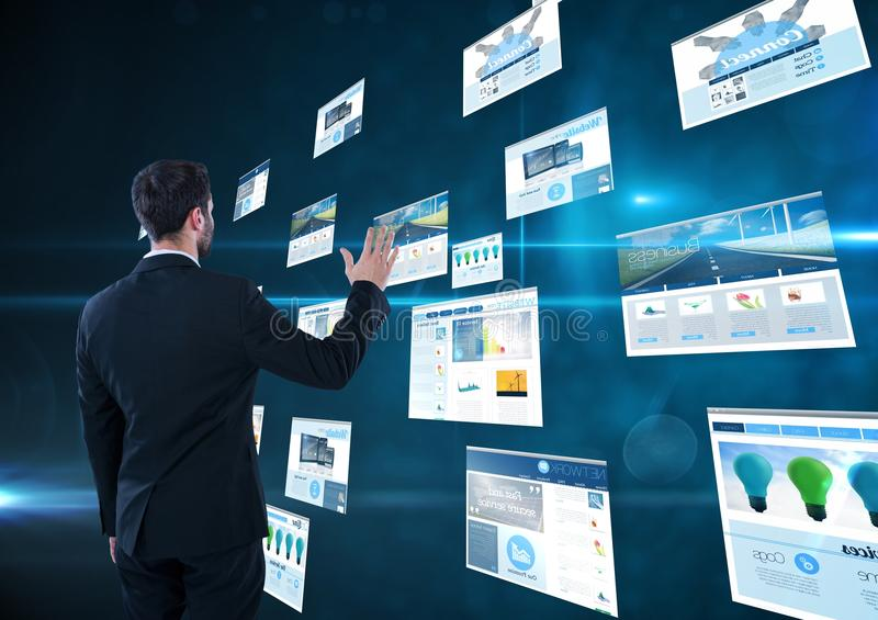 panels with websites(blue) dark blue background. business man doing thing on these stock image