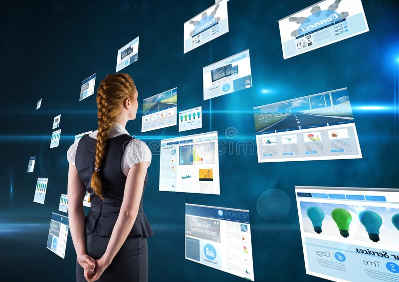 panels with websites(blue) dark blue background. Business woman with plait with his hands on the bac stock photo