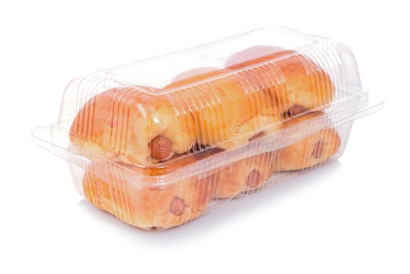 Panes en una caja de plástico transparente aislada foto de archivo libre de regalías