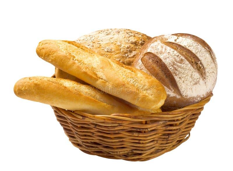 Panes y baguettes del pan en una cesta foto de archivo libre de regalías