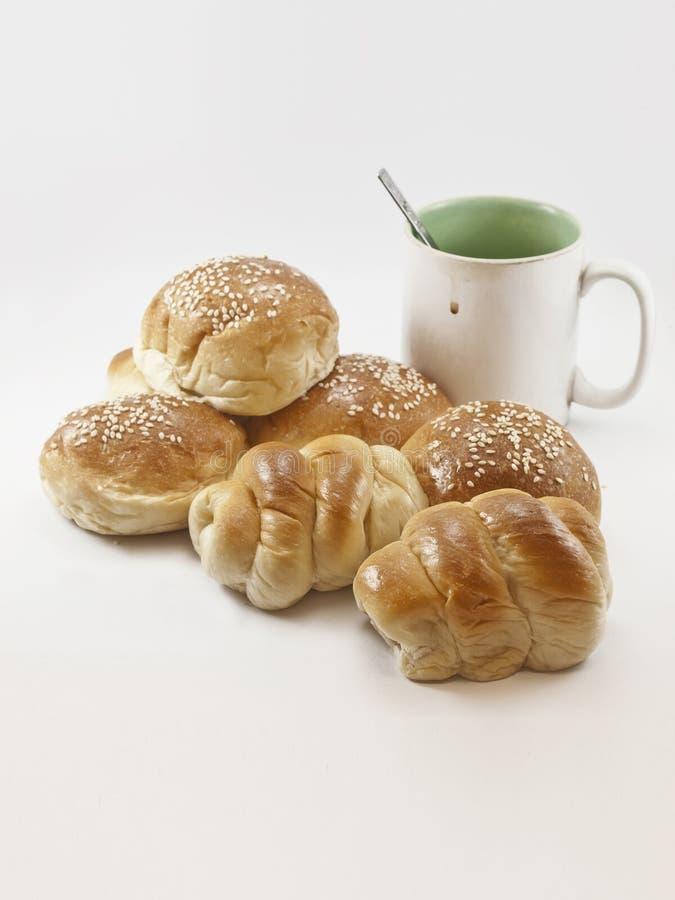 Panes y taza de café fotografía de archivo