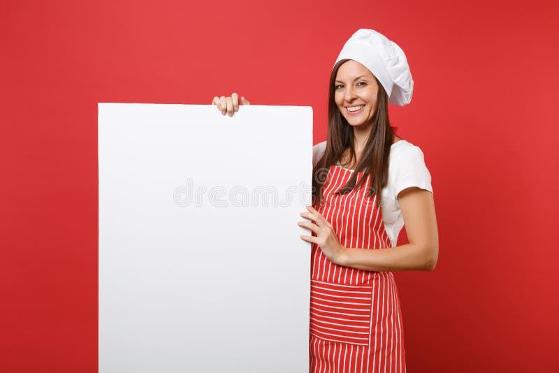 Panettiere femminile del cuoco del cuoco unico della casalinga in grembiule a strisce, maglietta bianca, cappello dei cuochi unic fotografia stock