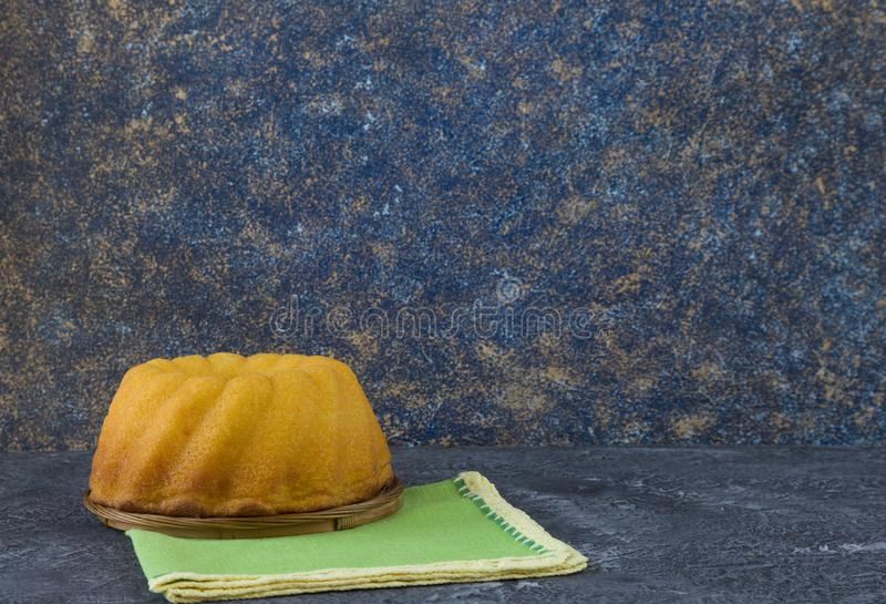 Panettone, easter bread on dark stone table with green linen napkins stock photography