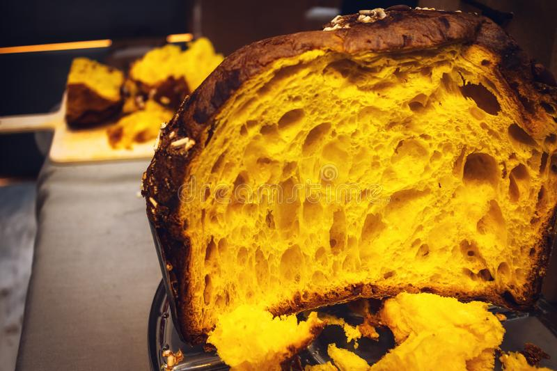 Panettone tasting event in italy, with the traditional italian christmas panetone sliced stock images