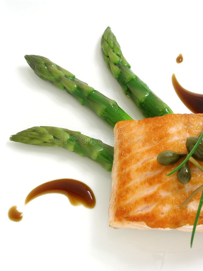 Panfried salmon with asparagus 2. Panfried salmon with asparagus and capers royalty free stock photos