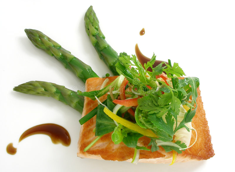 Panfried salmon with asparagus and salad stock photo