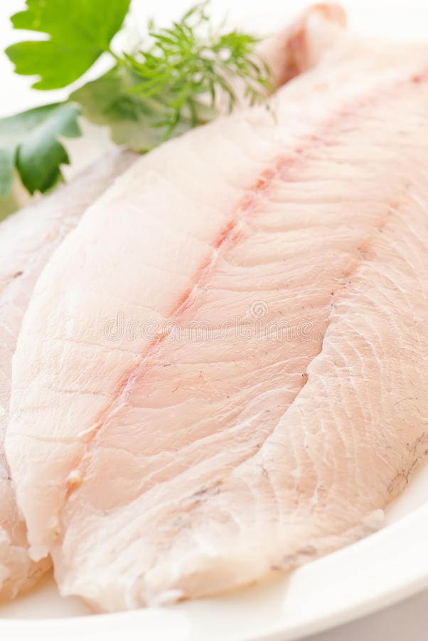 Pangasius filet. Raw with herbs royalty free stock images