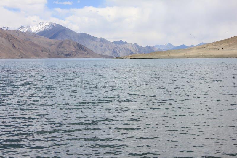 Pangong Lah ladhak Himalaya mountains, India. Pan gong lake  Leah ladhak Himalaya mountains, India, with beautiful cloudy sky stock image