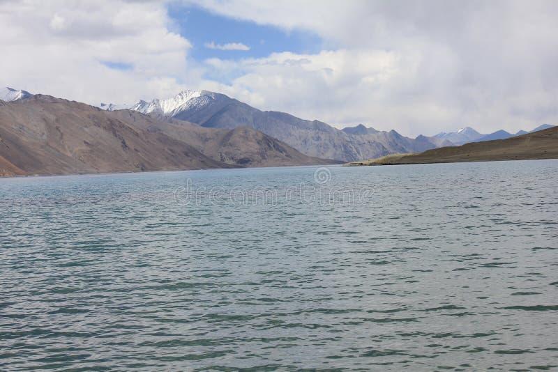 Pangong Lah ladhak Himalaya mountains, India. Pan gong lake  Leah ladhak Himalaya mountains, India, with beautiful cloudy sky stock images