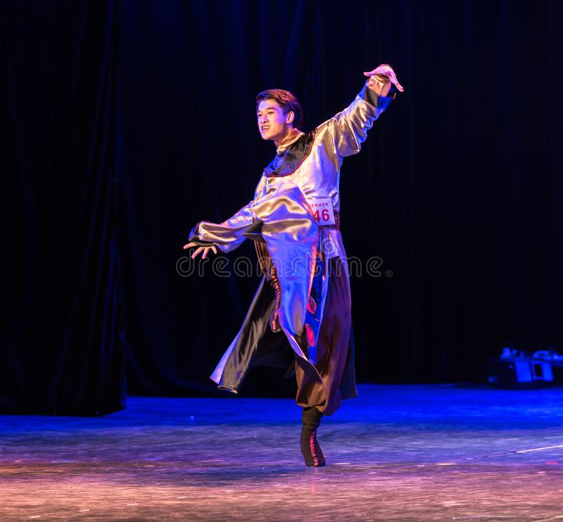 Mongolia man-Chinese Folk Dance-Graduation Show of Dance Departmen. Pangu`s pioneering work is a Chinese classical myth story. Dancers express the spiritual royalty free stock images