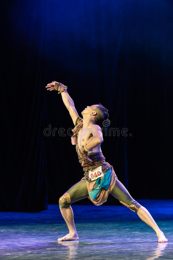 Input by canper 3-Chinese Folk Dance-Graduation Show of Dance Departmen. Pangu`s pioneering work is a Chinese classical myth story. Dancers express the spiritual stock image