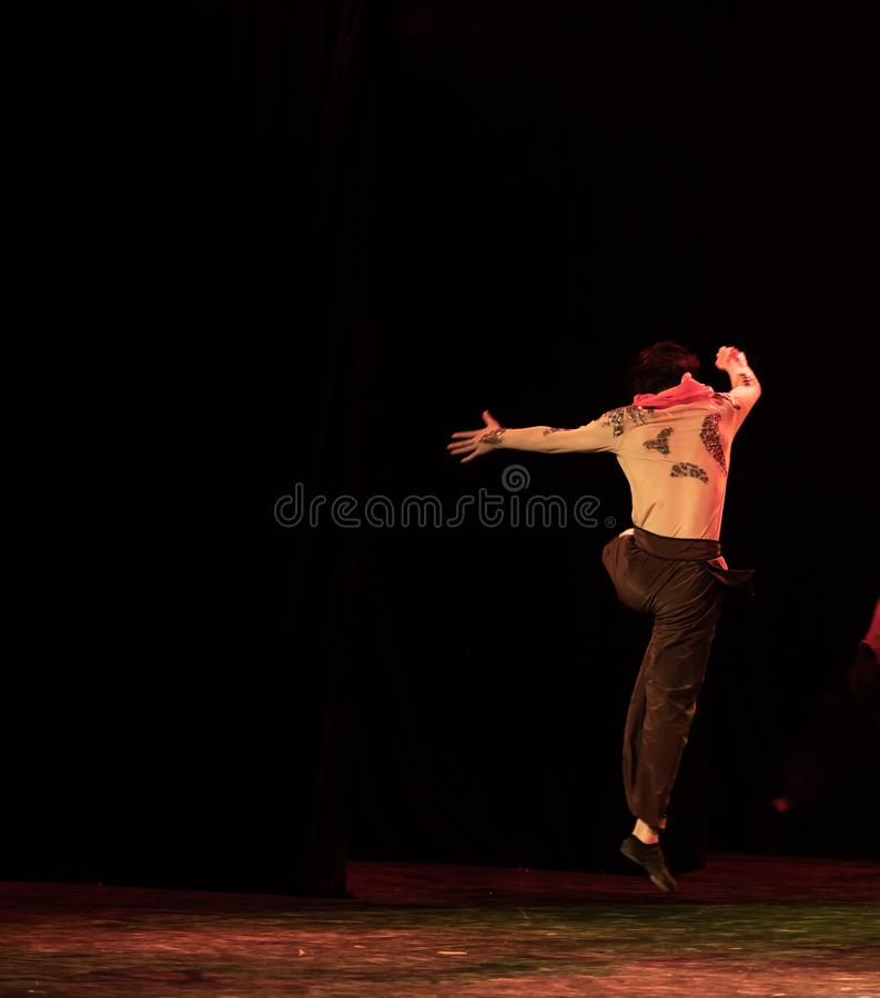 Input by canper 2-Chinese Folk Dance-Graduation Show of Dance Departmen. Pangu`s pioneering work is a Chinese classical myth story. Dancers express the spiritual royalty free stock photos