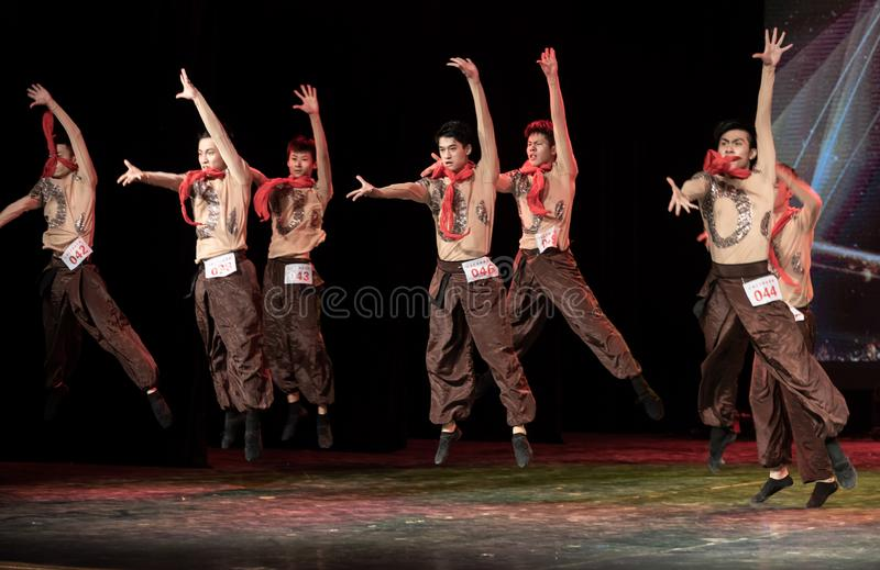 Input by canper 2-Chinese Folk Dance-Graduation Show of Dance Departmen. Pangu`s pioneering work is a Chinese classical myth story. Dancers express the spiritual stock photo