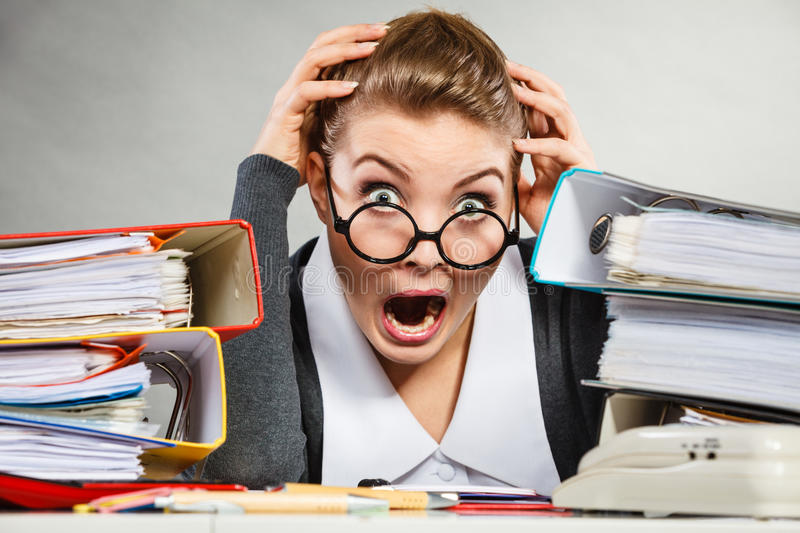 Panicked secretary at desk. Emotions shock corporation clerk administration concept. Panicked secretary at desk. Young nervous lady doing job in office stock photo