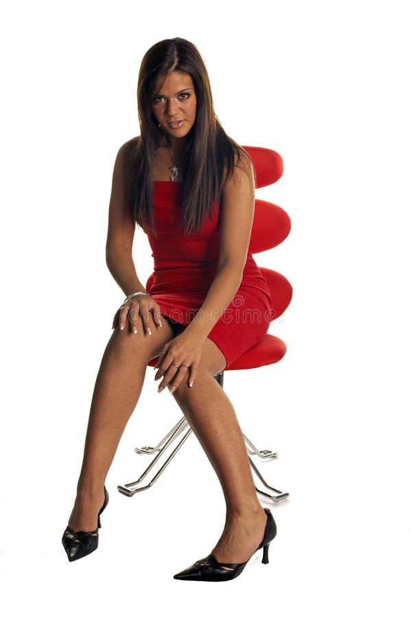 panie czerwony seksowna krzesło zdjęcia royalty free