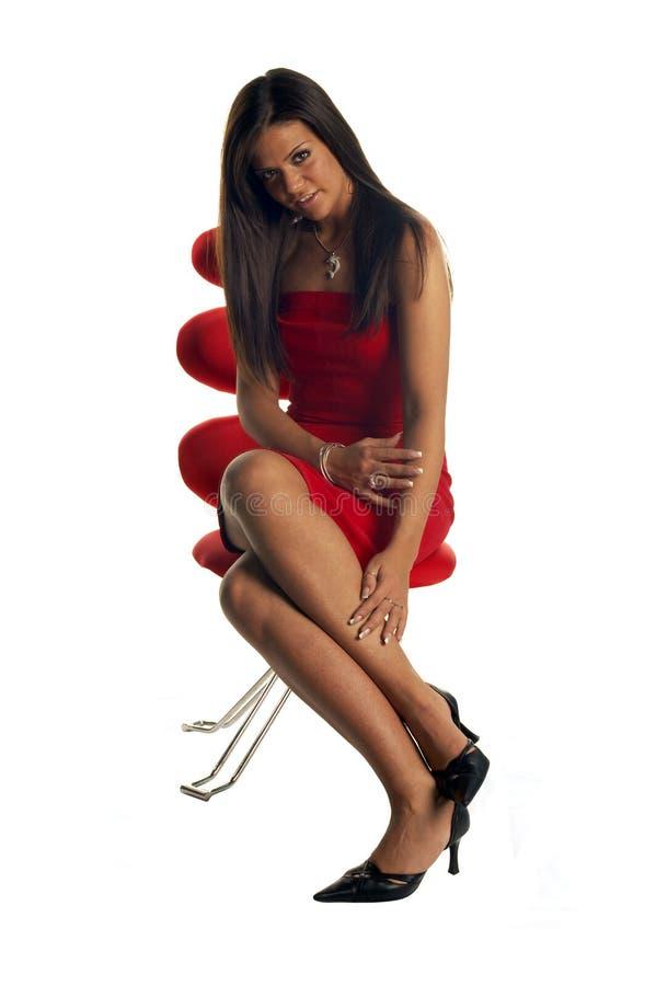 panie czerwony seksowna krzesło obrazy stock