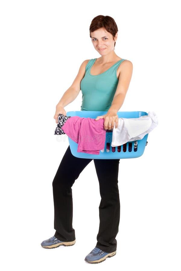 Panier de blanchisserie de fixation de femme image stock