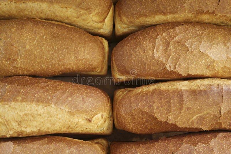Panieren Sie Hintergrund, Draufsicht von weißen Laiben Viele Brote geschossen von oben stockfotos