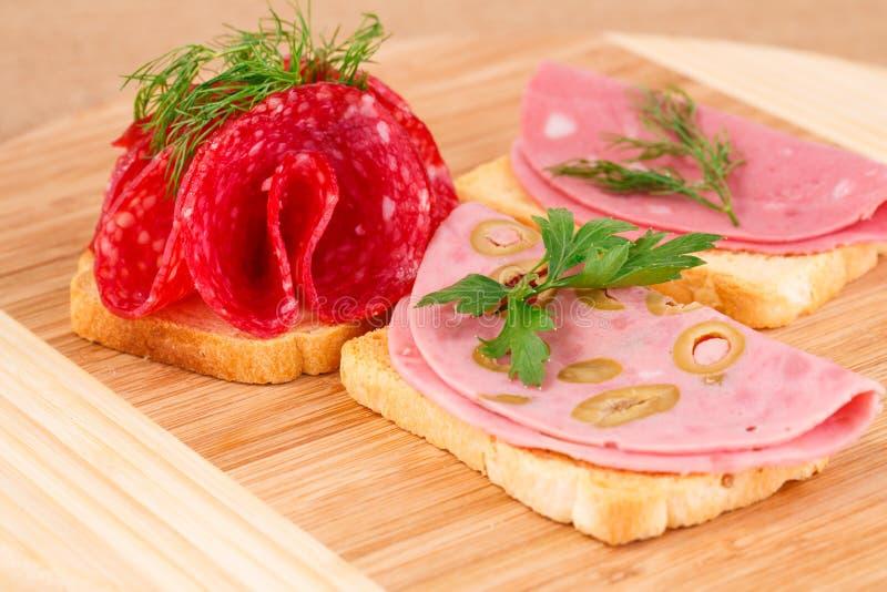 Panini con salame e mortadella fotografia stock libera da diritti