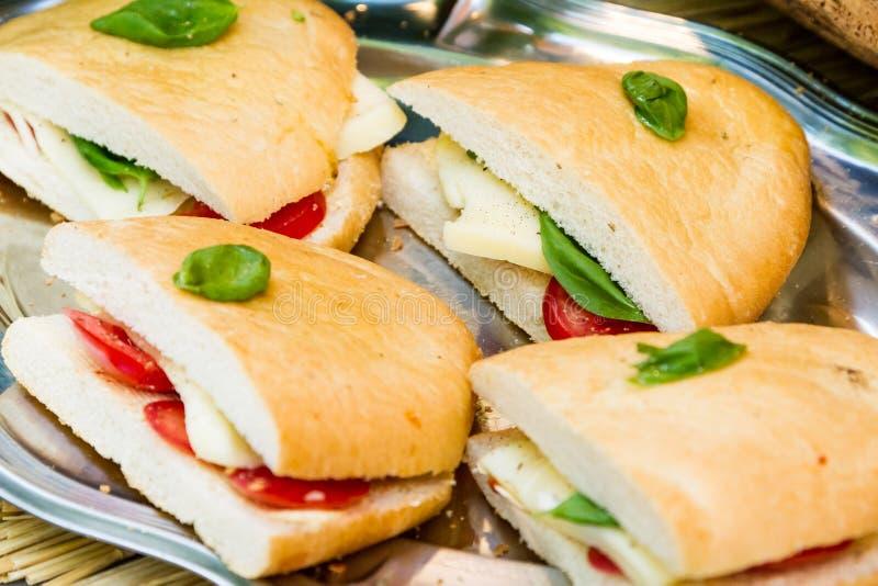 Panini kanapki z pomidorem i mozzarellą obrazy stock