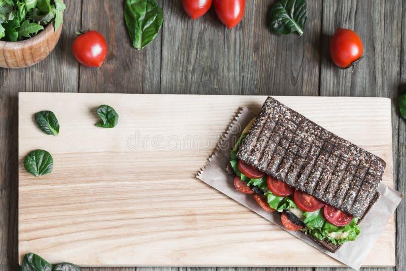 Panini - panino con pane nero immagine stock