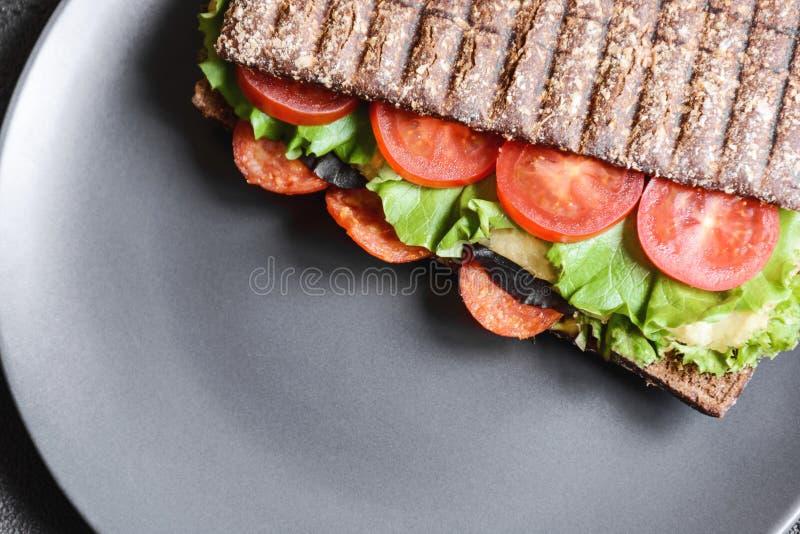 Panini - panino con pane nero fotografia stock