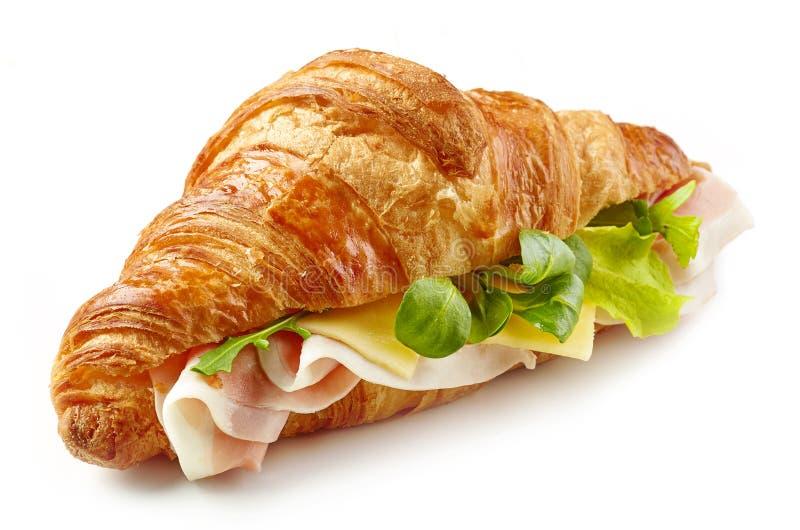 Panino del croissant con il prosciutto fotografia stock