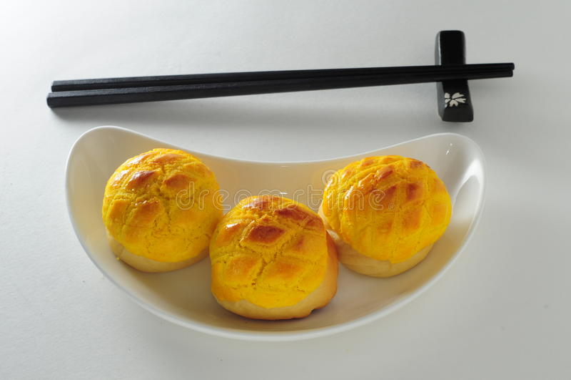 Panino imburrato dell'ananas al forno immagini stock libere da diritti