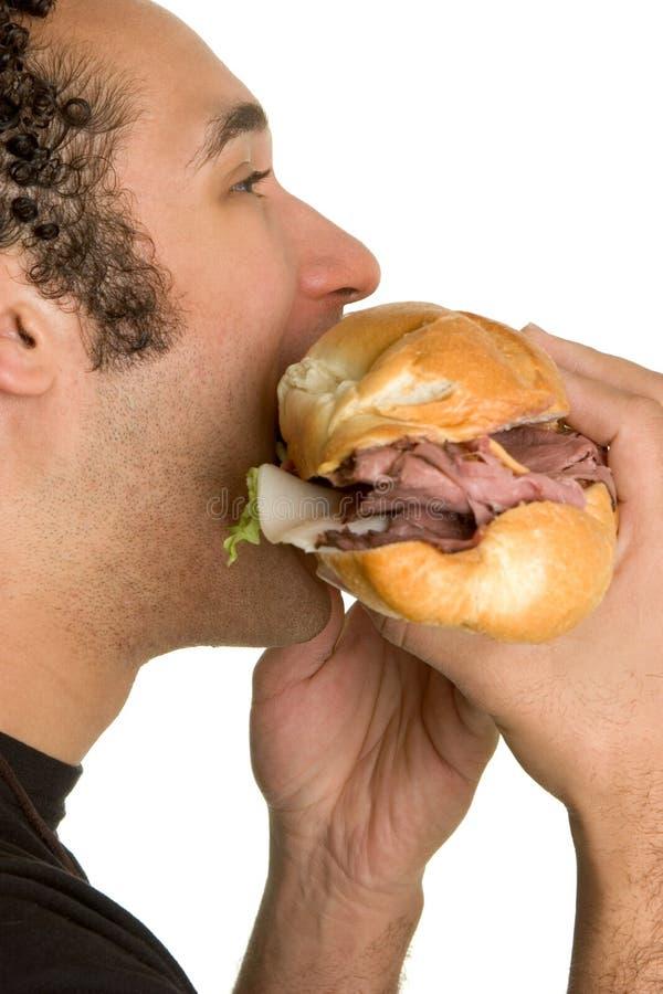 Panino mangiatore di uomini fotografia stock libera da diritti