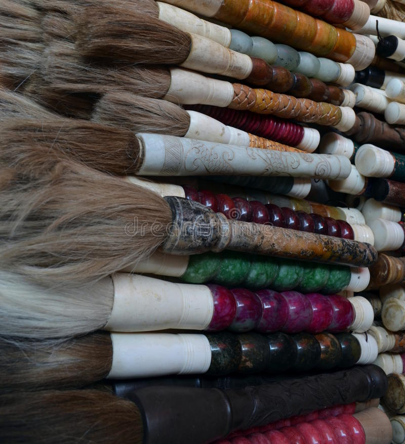 Panjiayuan market beijing China Calligraphy chinese brushes pens with decorations on sales at the market different style different. Size stock photo
